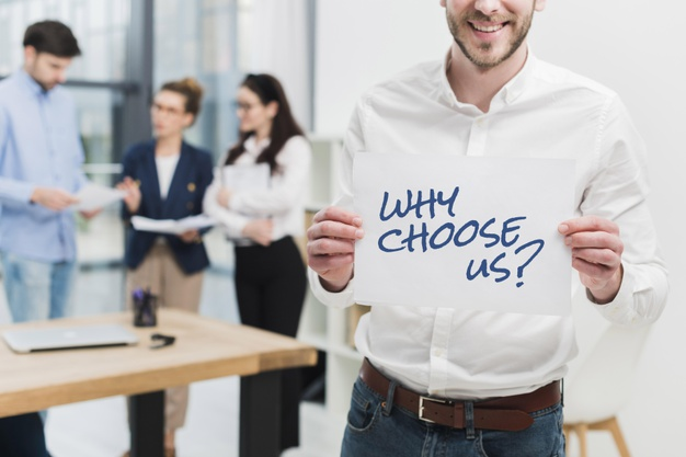 business-man-holding-paper-with-why-choose-us-question_23-2148932312